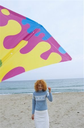 Young Woman with red Curls holding a Kite on a String - Leisure Time - Fun - Beach - Season Stock Photo - Premium Royalty-Free, Code: 628-02954653