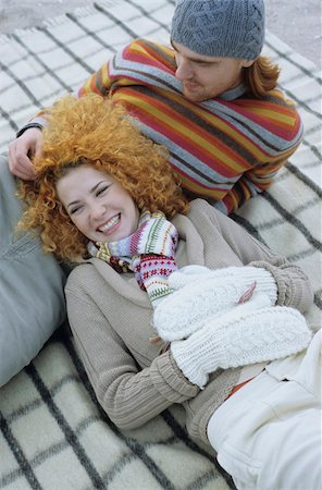 Young Woman with red Curls lying in the Lap of her Boyfriend - Relationship - Togetherness - Season Stock Photo - Premium Royalty-Free, Code: 628-02954666
