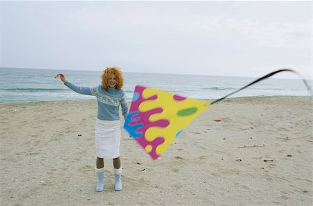 Young Woman with red Curls holding a Kite on a String - Leisure Time - Fun - Beach - Season Stock Photo - Premium Royalty-Free, Code: 628-02954672