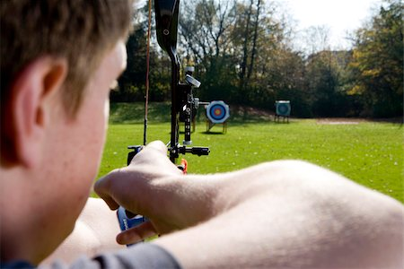 Archer aiming arrow at target board, Munich, Bavaria, Germany Stock Photo - Premium Royalty-Free, Code: 628-02953510