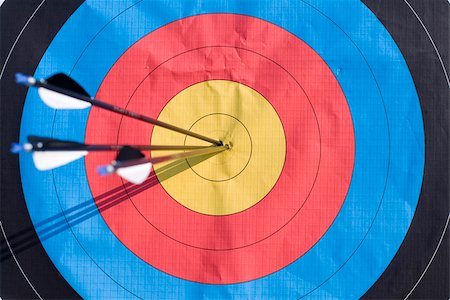 Arrows in centre of archery target, Munich, Bavaria, Germany Stock Photo - Premium Royalty-Free, Code: 628-02953513