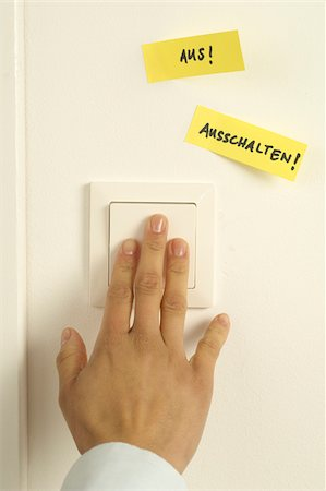Woman pressing light switch Stock Photo - Premium Royalty-Free, Code: 628-02953575