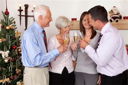 Parents and adult children celebrating Christmas together Stock Photo - Premium Royalty-Free, Code: 628-02953656