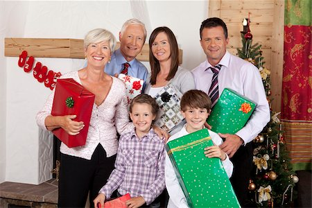 Grandparents, parents and children holding Christmas presents Stock Photo - Premium Royalty-Free, Code: 628-02953651