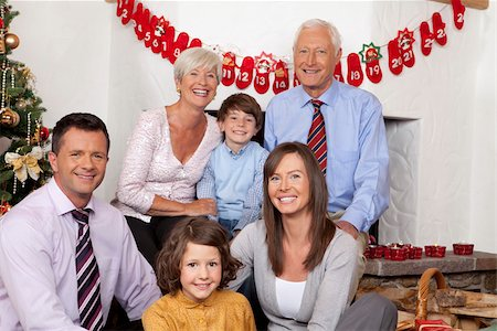 Grandparents, parents and children celebrating Christmas Stock Photo - Premium Royalty-Free, Code: 628-02953668