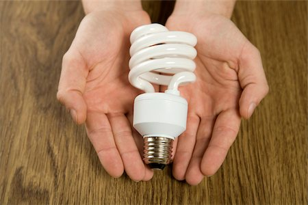 Energy efficient light bulb in hands, Germany Stock Photo - Premium Royalty-Free, Code: 628-02953717