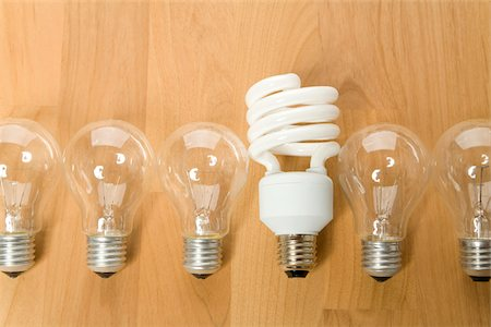 Energy efficient light bulb among conventional light bulbs, Germany Stock Photo - Premium Royalty-Free, Code: 628-02953739