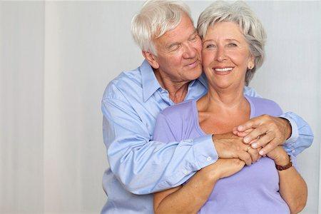 Happy senior couple hugging Stock Photo - Premium Royalty-Free, Code: 628-03201160