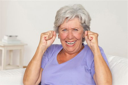 Senior woman cheering with clenched fists Stock Photo - Premium Royalty-Free, Code: 628-03201173