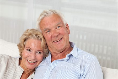Happy senior couple on sofa Stock Photo - Premium Royalty-Free, Code: 628-03201187