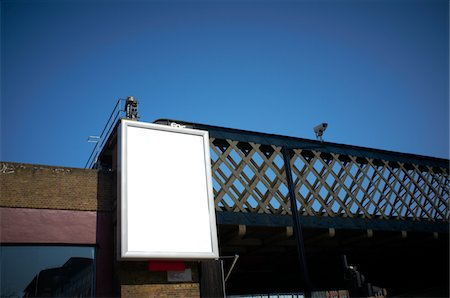 Blank sign against railway bridge Stock Photo - Premium Royalty-Free, Code: 621-05758579
