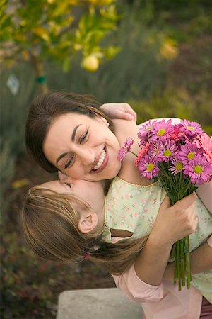 daughter kissing mother - Girl giving a woman a kiss Stock Photo - Premium Royalty-Free, Code: 621-00730047