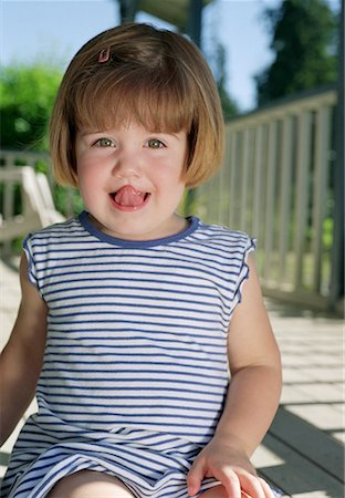 smiling toddler in stripes Stock Photo - Premium Royalty-Free, Code: 621-00744982