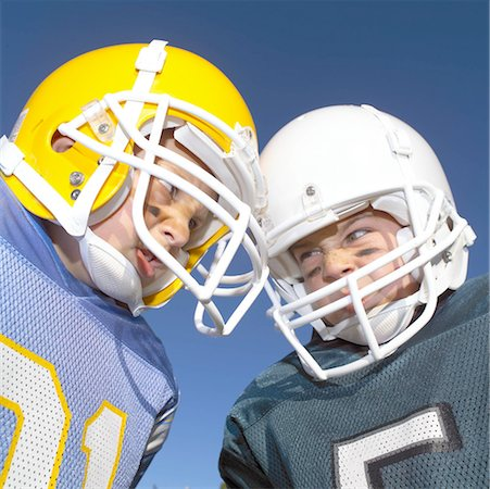 Pee Wee Leaguers Butting Heads Stock Photo - Premium Royalty-Free, Code: 621-00745556