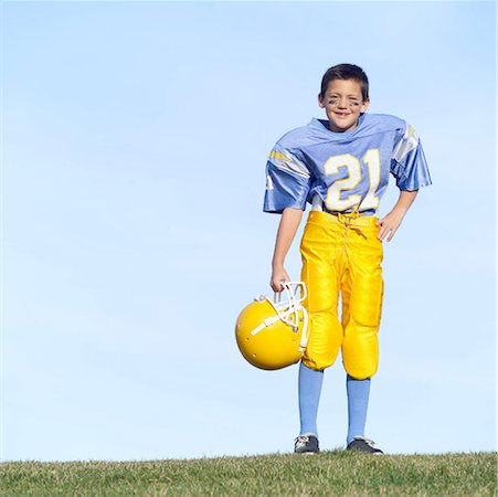 Pee Wee Football Player Stock Photo - Premium Royalty-Free, Code: 621-00745552