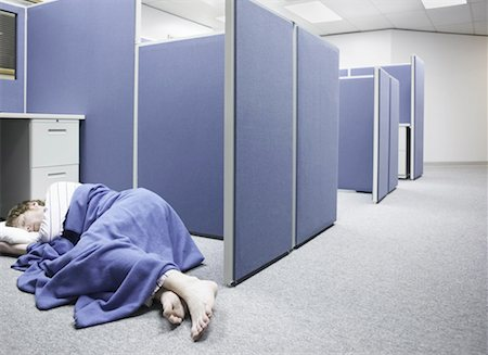 Sleeping in Office Cubicle Stock Photo - Premium Royalty-Free, Code: 621-00745856