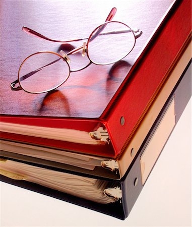 Glasses on binders Stock Photo - Premium Royalty-Free, Code: 621-00740968
