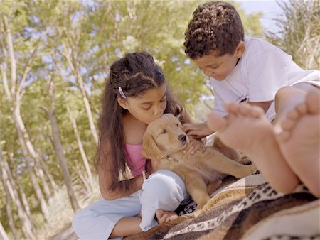 dog kissing girl - Kids with Puppy Stock Photo - Premium Royalty-Free, Code: 621-00742292