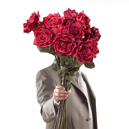 dozen roses - suitor presenting bouquet of red flowers Stock Photo - Premium Royalty-Free, Code: 621-00787724
