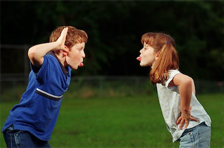 Sister and Brother Teasing Each Other Stock Photo - Premium Royalty-Free, Code: 621-00788262