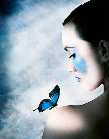 Beautiful Woman and Delicate Blue Butterfly Stock Photo - Premium Royalty-Free, Code: 621-00794361