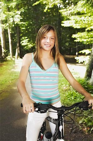 preteen  smile  one  alone - Girl in Blue Tank Top on Bicycle Stock Photo - Premium Royalty-Free, Code: 621-00795024