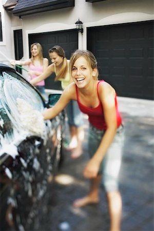Three Girls Washing Car Stock Photo - Premium Royalty-Free, Code: 621-00795035