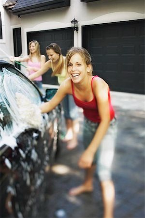 Three Girls Washing Car Stock Photo - Premium Royalty-Free, Code: 621-00795035
