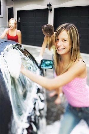 Three Girls Washing Car Stock Photo - Premium Royalty-Free, Code: 621-00795036