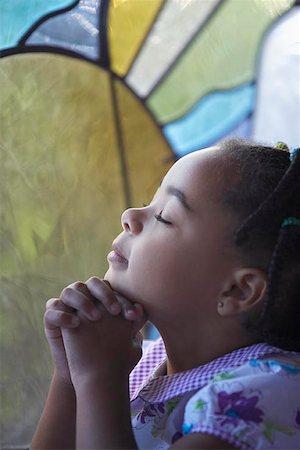 Three Year Old Girl Praying with Eyes Closed Stock Photo - Premium Royalty-Free, Code: 621-00795307