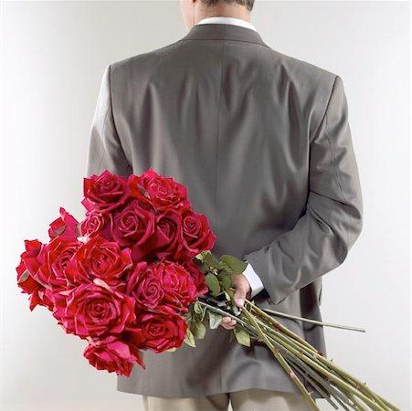 dozen roses - Gentleman Caller with Red Roses Stock Photo - Premium Royalty-Free, Code: 621-01006173