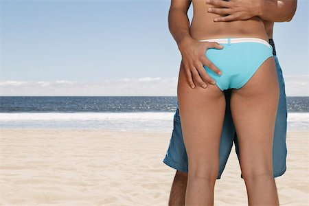 female rear end - Cropped Couple Embracing Stock Photo - Premium Royalty-Free, Code: 621-01007190