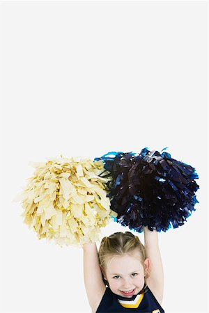 Little Girl Dressed as Cheerleader Stock Photo - Premium Royalty-Free, Code: 621-01008059