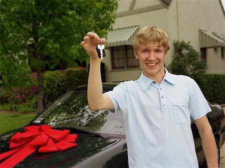 Teen Boy Showing Off the Keys to His New Car Stock Photo - Premium Royalty-Free, Code: 621-01008469
