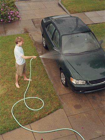 Teen Boy Washing Car Stock Photo - Premium Royalty-Free, Code: 621-01008460