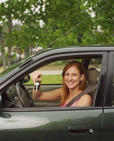 Teen Girl Holding Keys in Driver's Seat of Car Stock Photo - Premium Royalty-Free, Code: 621-01008470