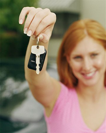 Teen Girl Showing Off Her New Car Keys Stock Photo - Premium Royalty-Free, Code: 621-01008472