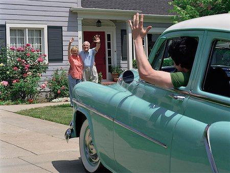 Waving Goodbye to Departing Car Stock Photo - Premium Royalty-Free, Code: 621-01009147