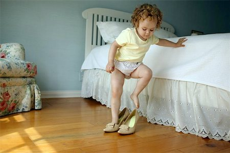 Walking in Mommy's Shoes Stock Photo - Premium Royalty-Free, Code: 621-01003221