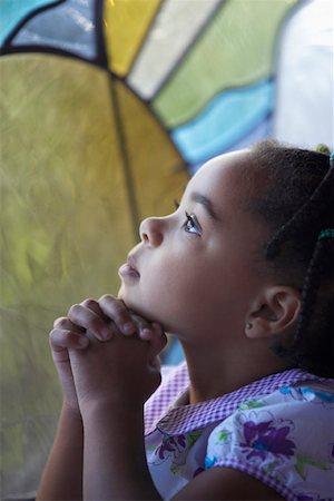 Three Year Old Girl Praying Stock Photo - Premium Royalty-Free, Code: 621-01012972