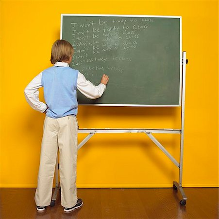 Boy Writing on Chalkboard Stock Photo - Premium Royalty-Free, Code: 621-01114042