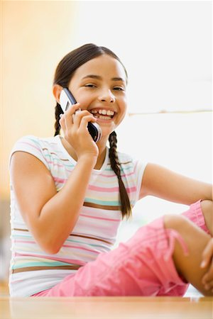 preteen  smile  one  alone - Pre-teen girl talking on cell phone Stock Photo - Premium Royalty-Free, Code: 621-01200542