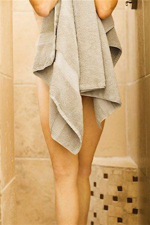 Woman holding towel Stock Photo - Premium Royalty-Free, Code: 621-01225308