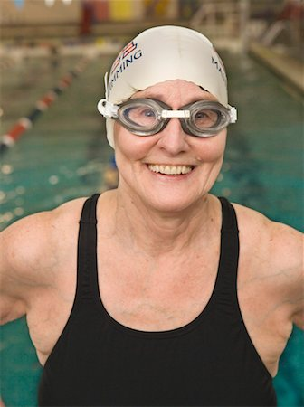 seniors and swim cap - Smiling senior citizen swimmer Stock Photo - Premium Royalty-Free, Code: 621-01225417