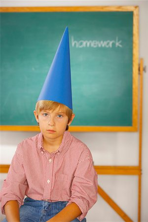 Boy wearing dunce cap Stock Photo - Premium Royalty-Free, Code: 621-01225578