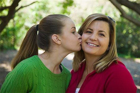 Girl kissing mother on cheek Stock Photo - Premium Royalty-Free, Code: 621-01554101