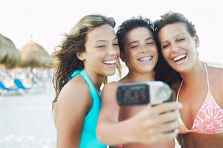Teenagers taking a picture on beach Stock Photo - Premium Royalty-Free, Code: 621-01553943