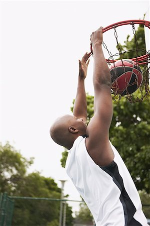 scoring - Man dunking basketball Stock Photo - Premium Royalty-Free, Code: 621-01799201