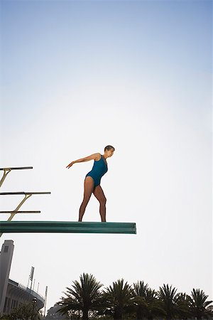 seniors woman in swimsuit - Senior woman on high diving board Stock Photo - Premium Royalty-Free, Code: 621-01799911