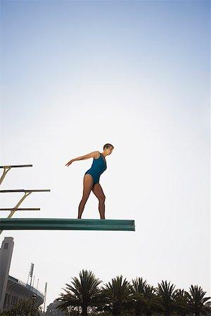 seniors woman in swimsuit - Senior woman on high diving board Stock Photo - Premium Royalty-Free, Code: 621-01799911
